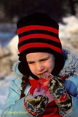 FA07-004z  Child tasting ice - temperature cold