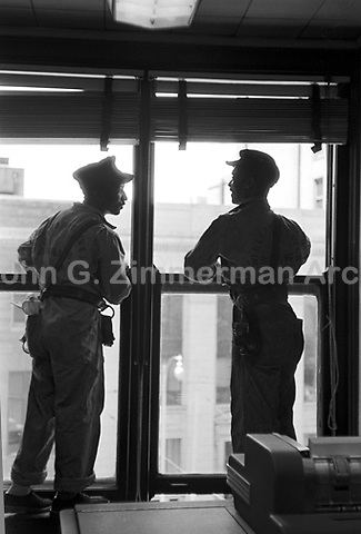 Window washers at work on Atlanta high-rise building, Atlanta, Georgia, 1952. Credit: © John G. Zimmerman Archive
