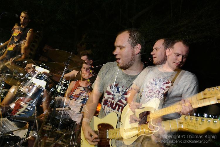 Kaohsiung, Taiwan -- Triple exposure of British Rock 'n' Roll band GOOBER GUN in action.