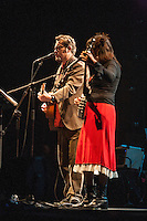 "The Handsome Family performing at the Leonard Cohen Tribute Concert in Dublin in 2006. The Handsome Family is an alternative country and Americana duo consisting of husband and wife Brett and Rennie Sparks formed in Chicago, Illinois, and currently based in Albuquerque, New Mexico. They are perhaps best known for their song ""Far from Any Road"" from the album Singing Bones, which was used as the main title theme for the first season of HBO's 2014 crime drama True Detective. The Handsome Family participated in a series of Leonard Cohen tribute concerts, called ""Came So Far for Beauty"", produced and arranged by Hal Willner, performing along with Nick Cave, The McGarrigles, Martha Wainwright, Rufus Wainwright, Jarvis Cocker, Beth Orton, Laurie Anderson, Linda Thompson, Antony Hegarty, and Cohen's original backing singers Perla Batalla and Julie Christensen. The concerts were performed in New York, Brighton, Dublin and Sydney. The Sydney concert was filmed and became Leonard Cohen: I'm Your Man, a film tribute to the legendary songwriter. A CD soundtrack featuring select covers from the tribute concerts was released by Verve Records in 2006;"