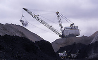 A bucket that can hold 170 cubic yards of material while unearthing rock down to a coal seam. Arch Coal company employs over 500 workers at Black Thunder, which for many years was the nation's single largest coal mine in Wyoming's Powder River Basin.....Black Thunder works coal reserves with five draglines in the 70 foot Wyodak seam producing more than 65 million tons of coal annually on federal land. The low-sulphur, sub-bituminous coal is suitable for power station fuel without any preparation except crushing. ..Black Thunder produces more than two tons of coal per second, 24 hours a day, 365 days a year. The mine surpassed a 750 million ton shipment milestone 25 years after opening in 1977.