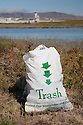"A full trash bag at Bayfront Park. Volunteers in the City of Millbrae participated in California Coastal Cleanup Day on 9/19/09. Participants cleaned up inland locations throughout the city as well as at Bayfront Park on the San Francisco Bay shoreline. The inland cleanup efforts were important because, according to the California Coastal Commission, ""past Coastal Cleanup Day data tell us that most (between 60-80 percent) of the debris on our beaches and shorelines comes from inland sources, traveling through storm drains or creeks out to the beaches and ocean. Rain or even something as simple as hosing down a sidewalk can wash cigarette butts, bits of styrofoam, pesticides, and oil into the storm drains and out to the ocean."" The California Coastal Cleanup Day (http://www.coastal.ca.gov/publiced/ccd/ccd.html) is sponsored by the California Coastal Commission and is a part of the International Coastal Cleanup organized by The Ocean Conservancy."