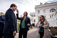 A White House staff member has their temperature checked prior to entering the West Wing at the White House in Washington, DC, March 17, 2020, in Washington, D.C. The White House checking temperatures as part of their Coronavirus screening. <br /> Credit: Kevin Dietsch / Pool via CNP/AdMedia