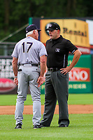 Kane County Cougars manager Butch Hobson (17) and base umpire James Folske during game one of a Midwest League doubleheader against the Wisconsin Timber Rattlers on June 23, 2017 at Fox Cities Stadium in Appleton, Wisconsin.  Kane County defeated Wisconsin 4-3. (Brad Krause/Krause Sports Photography)