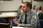 Nevada Chief Game Warden Tyler Turnipseed testifies in a commitee hearing at the Legislative Building in Carson City, Nev., on Thursday, April 30, 2015. <br /> Photo by Cathleen Allison