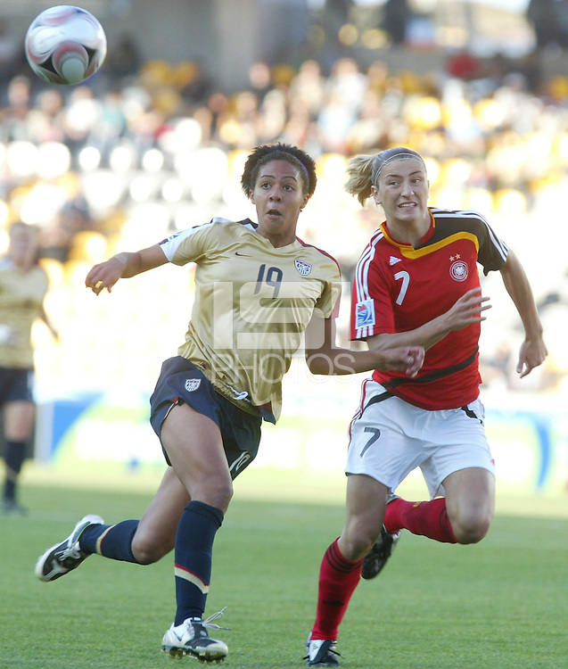 Coquimbo, Chile: American's player Sydney Leroux (L) dispute the ball with germany´s player Bianca Schmidt during the semi-final match in the Fifa U-20 Women´s World Cup at Francisco Sanchez Rumoroso stadium in Coquimbo, located at 459 kilometers north of Santiago, on December 4 th, 2008. By Grosnia / ISIphotos.com
