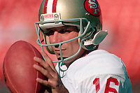 SAN FRANCISCO, CA - Quarterback Joe Montana of the San Francisco 49ers warms up before a game at Candlestick Park in San Francisco, California in 1989. Photo by Brad Mangin
