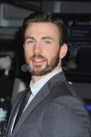 NEW YORK, NY - APRIL 1: Chris Evans rings the opening bell at the New York Stock Exchange promoting Marvel's Captain America: The Winter Soldier film on April 1, 2014 in New York City. Credit: mpi01/MediaPunch
