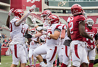 Hawgs Illustrated/BEN GOFF <br /> Players celebrate after a touchdown catch by tight end Grayson Gunter in the fourth quarter Saturday, April 6, 2019, after the Arkansas Red-White game at Reynolds Razorback Stadium.