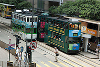 Double decker trams passing each other in the street, Hong Kong Island, Hong Kong, China.