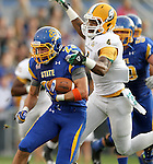BROOKINGS, SD - SEPTEMBER 14:  Brandon Hubert #23 from South Dakota State University is brought down from behind by Theo Alexander #4 from Southeastern Louisiana in the first quarter of their game Saturday night at Coughlin Alumni Stadium in Brookings. (Photo by Dave Eggen/Inertia)