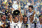 07 December 2014: Los Angeles's Marcelo Sarvas (BRA) (left) with Landon Donovan (right) lifts the Philip F. Anschutz Trophy overhead. The Los Angeles Galaxy played the New England Revolution in Carson, California in MLS Cup 2014. Los Angeles won 2-1 in overtime.