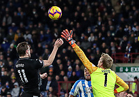 Burnley's Chris Wood beats  Huddersfield Town's goalkeeper Jonas Lossl in the air but his header goes wide of goal<br /> <br /> Photographer Andrew Kearns/CameraSport<br /> <br /> The Premier League - Huddersfield Town v Burnley - Wednesday 2nd January 2019 - John Smith's Stadium - Huddersfield<br /> <br /> World Copyright © 2019 CameraSport. All rights reserved. 43 Linden Ave. Countesthorpe. Leicester. England. LE8 5PG - Tel: +44 (0) 116 277 4147 - admin@camerasport.com - www.camerasport.com