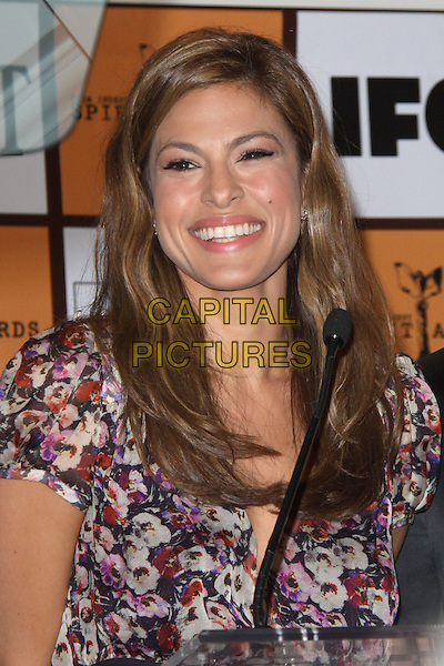 EVA MENDES.attending 2011 Film Independent Spirit Award Nominations Press Conference held at The London West Hollywood Hotel in West Hollywood, California, USA, November 30th, 2010.   .portrait headshot smiling pink purple black floral print white red pansy indie .CAP/RKE/TDM.©Tony DiMaio/RockinExposures/Capital Pictures.