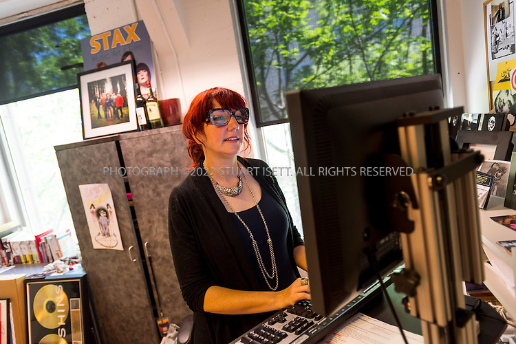 7/1/2014&mdash;Seattle, WA, USA<br /> <br /> Executive Vice President of Sub Pop Records, Megan Jasper, working in the company's offices in Seattle, WA.<br /> <br /> Photograph by Stuart Isett<br /> &copy;2014 Stuart Isett. All rights reserved.