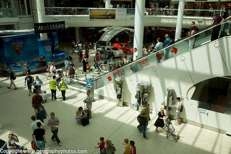 Departure lounge area with duty free shops at Gatwick airport, England