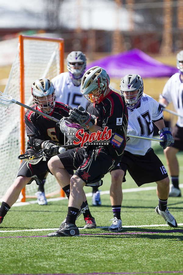 Dale Mattice (44) of the VMI Keydets has the ball knocked loose against the High Point Panthers at Vert Track, Soccer & Lacrosse Stadium on March 8, 2014 in High Point, North Carolina.  The Panthers defeated the Keydets 9-8.   (Brian Westerholt/Sports On Film)