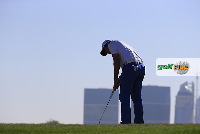 Adrian OTAEGUI (ESP) takes his putt on the 10th green during Wednesday's Round 1 of the 2015 Commercial Bank Qatar Masters held at Doha Golf Club, Doha, Qatar.: Picture Eoin Clarke, www.golffile.ie: 1/21/2015