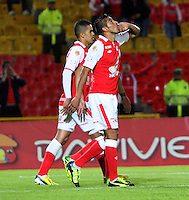 BOGOTA -COLOMBIA- 21-08-2013. Silvio Gonzalez de Independiente Santa Fe  celebra su gol contra  Patriotas de Boyacá , partido correspondiente a la  quinta fecha de la Liga Postobón segundo semestre disputado en el estadio Nemesio Camacho El Campin     / Silvio Gonzalez of Independiente Santa Fe celebrates his goal against Patriots Boyaca game for the fifth round of the second half Postobón League match at the  Nemesio Camacho El Campin stadium  . Photo: VizzorImage /Felipe Caicedo  / STAFF