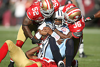 11/08/09 San Francisco, CA: LB Patrick Willis #52, CB Shawntae Spencer #36 of the San Francisco 49ers  sack Tennessee Titans QB Vince Young #10 in an NFL game played at Candelstick Park. The Titans defeated the 49ers 34-27