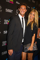 "GOLD COAST, Queensland/Australia (Friday, February 24, 2012) Jordy Smith (ZAF) with girlfriend Lyndall Jarvis (ZAF). – The 29th Annual ASP World Surfing Awards went off tonight at the Gold Coast Convention and Exhibition Centre with the world's best surfers trading the beachwear for formal attire as the 2011 ASP World Champions were officially crowned.. .Kelly Slater (USA), 40, and Carissa Moore (HAW), 19, took top honours for the evening, collecting the ASP World Title and ASP Women's World Title respectively.. .""I have actually been on tour longer than some of my fellow competitors have been alive,"" Slater said. ""All joking aside, it's truly humbling to be up here and honoured in front of such an incredible collection of surfers. I want to thank everyone in the room for pushing me to where I am.""..In addition to honouring the 2011 ASP World Champions, the ASP World Surfing Awards included new accolades voted on by the fans and the surfers themselves...For the first time in several years, ASP Life Membership was awarded to Hawaiian legend and icon of high-performance surfing, Larry Bertlemann (HAW), 56...""Where surfing is today is where I dreamed it should be in the 70's,"" Bertlemann said. ""You guys absolutely deserve this and I'm so honored to be up here in front of you all tonight."".Grammy Award-winning artists Wolfmother and The Vernons rounded out the night's entertainment which was all streamed LIVE around the world on YouTube.com..Photo: joliphotos.com"