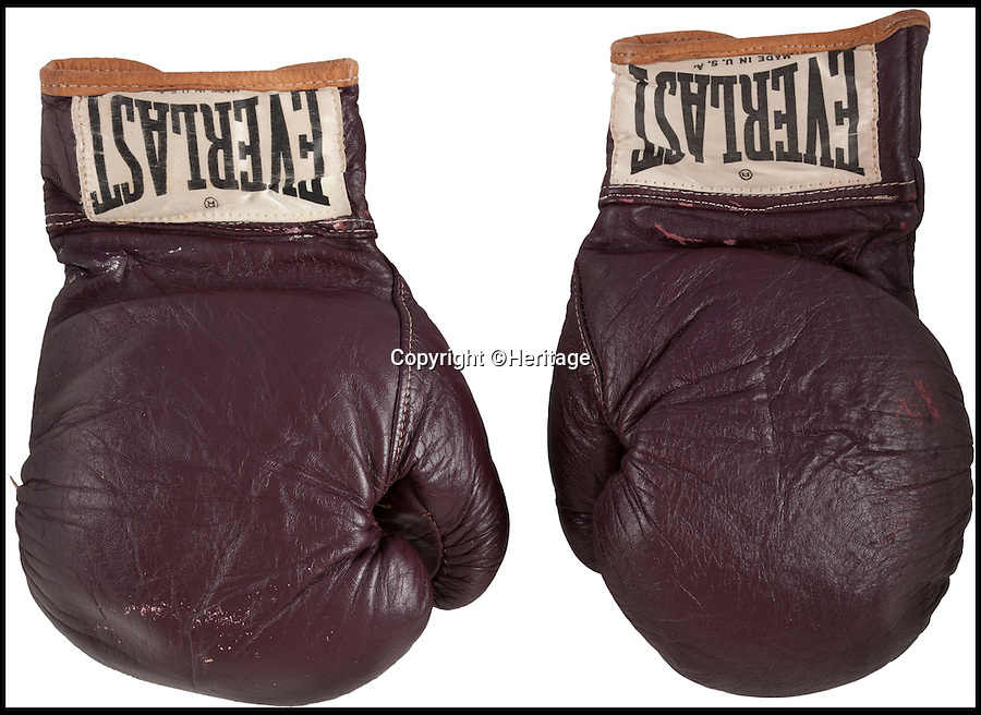 BNPS.co.uk (01202 558833)<br /> Pic: Heritage/BNPS<br /> <br /> ***Use Full Byline***<br /> <br /> The gloves worn by Muhamma Ali in his first ever professional defeat against 'Smokin' Joe Frazier in March 1971 are set to go on auction on July 31st. <br /> <br /> The boxing gloves worn by Muhammad Ali in his first ever professional defeat at the hands of arch-rival 'Smokin' Joe' Frazier have emerged for sale for 300,000 pounds.<br /> <br /> The gloves were used by the boxing hero when he took to the ring against Frazier in March 1971 in a bout billed as the 'Fight of the Century'.<br /> <br /> Frazier was the most intimidating fighter at the time and the match, in New York's Madison Square Garden on March 8, 1971, was one of the most anticipated in the sport's history.<br /> <br /> The fight resulted in Ali's first ever professional loss and set the stage for a thrilling rematch against Frazier in New York in 1974 and the series decider, the Thrilla in Manilla, the following year, both of which Ali won.<br /> <br /> Experts have tipped them to fetch upwards of 300,000 pounds when they go under the hammer in the Heritage Auctions sale in Cleveland, Ohio, on July 31.<br /> <br /> And they could challenge the current world record for boxing memorabilia set in February this year when a pair of Ali's gloves from his 1964 heavyweight victory against Sonny Liston sold for 540,000 pounds.