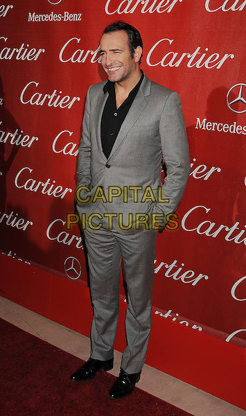 Jean Dujardin.The 2012 Palm Springs Film Festival Awards Gala at the Palm Springs Convention Center in Palm Springs, California, USA..January 7th, 2012.full length suit hands in pockets black shirt grey gray  .CAP/ROT/TM.©Tony Michaels/Roth Stock/Capital Pictures