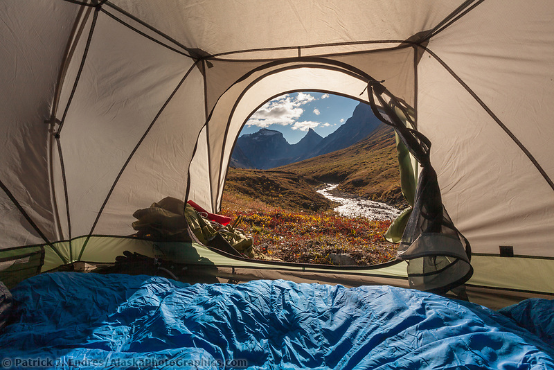 Camping with a view from the tent over Arrigetch creek valley, Xanadu (left) Arial and Caliban mountains, Brooks range, Gates of the Arctic National Park, Alaska.