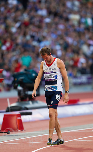 04 AUG 2012 - LONDON, GBR - Rhys Williams (GBR) of Great Britain walks from the finish of the third men's 400m Hurdles semi final at the London 2012 Olympic Games athletics at the Olympic Stadium in the  Olympic Park, Stratford, London, Great Britain.(PHOTO (C) 2012 NIGEL FARROW)