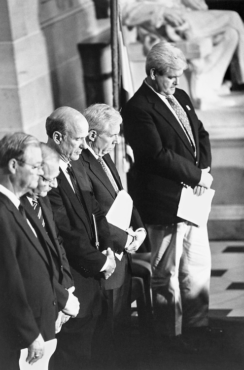 "Rep. Isaac Newton ""Ike"" Skelton IV, D-Miss., Rep. Paul E. Kanjorski, D-Pa., Rep. Charles Patrick ""Pat"" Roberts, R-Kans., Rep. Frank Rudolph Wolf, R-Va., and Speaker of the House Rep. Newton Leroy ""Newt"" Gingrich, R-Ga., gather at a Memorial Service. July 12, 1996 (Photo by Laura Patterson/CQ Roll Call)"