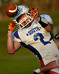 Evan Tanner of the South bobbles the ball before coming up with a pass reception on the sideline setting up a touchdown in the second quarter.