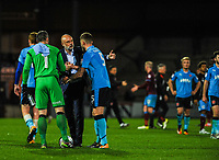 Fleetwood Town's manager Uwe Rosler congratulates Ash Eastham during the Sky Bet League 1 match between Scunthorpe United and Fleetwood Town at Glanford Park, Scunthorpe, England on 17 October 2017. Photo by Stephen Buckley/PRiME Media Images