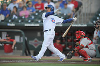 Iowa Cubs Willson Contreras (40) swings during the Pacific Coast League game against the Memphis Redbirds at Principal Park on June 6, 2016 in Des Moines, Iowa.  Memphis won 6-2.  (Dennis Hubbard/Four Seam Images)