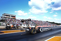 Aug. 16, 2013; Brainerd, MN, USA: NHRA top fuel dragster driver Shawn Langdon (near lane) races alongside Tony Schumacher during qualifying for the Lucas Oil Nationals at Brainerd International Raceway. Mandatory Credit: Mark J. Rebilas-