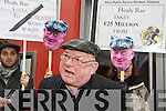 Jackie Healy Rae TD meets angry Civil Servants who protested outside his clinic in Scott's bar Killarney on Saturday