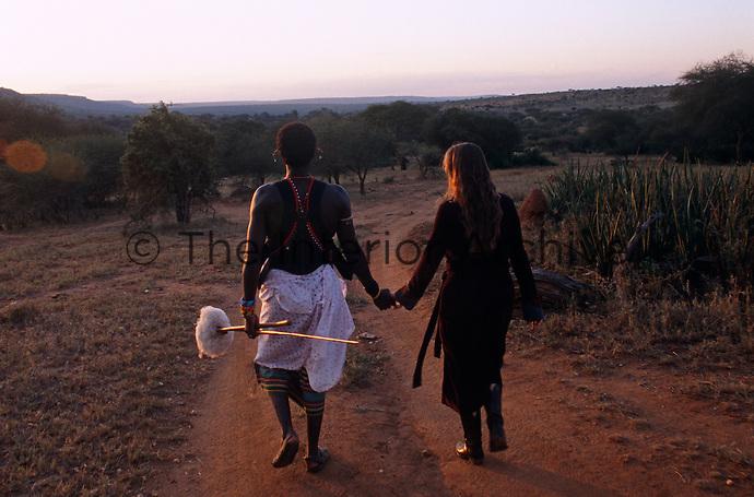 Anna and Lemarti walking through the Samburu