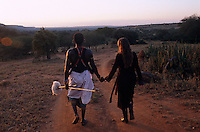 Anna and Lemarti walking through the Samburu