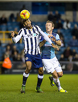 Shaun Cummings of Millwall and Garry Thompson of Wycombe Wanderers during the Checkatrade Trophy round two Southern Section match between Millwall and Wycombe Wanderers at The Den, London, England on the 7th December 2016. Photo by Liam McAvoy.