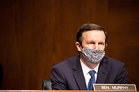 """United States Senator Chris Murphy (Democrat of Connecticut), listens during the US Senate Health, Education, Labor, and Pensions Committee  hearing titled """"COVID-19: Going Back to School Safely"""" on Capitol Hill in Washington, DC on Thursday, June 4, 2020.<br /> Credit: Ting Shen / CNP/AdMedia"""