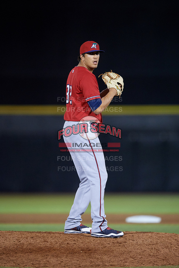 Fort Myers Miracle relief pitcher Andrew Vasquez (32) gets ready to deliver a pitch during a game against the Dunedin Blue Jays on April 17, 2018 at Dunedin Stadium in Dunedin, Florida.  Dunedin defeated Fort Myers 5-2.  (Mike Janes/Four Seam Images)