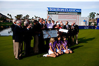 Officials, Board of Directors, The Classic Girls, Yogi Berra and 2010 Bob Hope Classic Champion Bill Haas pose during the awards ceremony at the conclusion of the event.