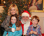 Santa Claus with Another World's and Blue Bloods Amy Carlson - daughter Lyla - son Nigel - Hearts of Gold links to a better life celebrates Christmas with a party #3 for mothers and their children on December 22, 2016 in New York City, New York with arts and crafts, a great turkey dinner with all the goodies and then the children met Santa Claus and had a photo with him as he gave them gifts. (Photo by Sue Coflin/Max Photos)