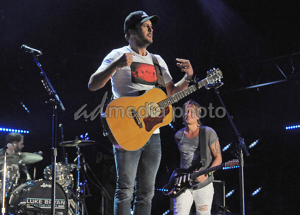 12 June 2016 - Nashville, Tennessee - Luke Bryan and Keith Urban. 2016 CMA Music Festival Nightly Concert held at Nissan Stadium. Photo Credit: Dara-Michelle Farr/AdMedia