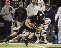 NWA Democrat-Gazette/CHARLIE KAIJO Bentonville High School Landon Beeler (30) completes a pass during a football game, Friday, November 2, 2018 at Bentonville High School in Bentonville.