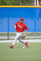 Philadelphia Phillies Austin Listi (24) fields a base hit during an Instructional League game against the Toronto Blue Jays on October 7, 2017 at the Englebert Complex in Dunedin, Florida.  (Mike Janes/Four Seam Images)