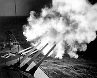 The USS Missouri fires 16-inch shell into enemy lines at Hungnam.  A 16-inch 3-gun salvo is on its way to commies.  December 26, 1950. (Navy)<br /> NARA FILE #:  080-G-426954<br /> WAR & CONFLICT BOOK #:  1445