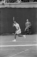 American tennis player Dick Savitt in quarterfinal of 1956 U.S. Men's National Championships against Australian Ken Rosewall. West Side Tennis Club, Forest Hills, New York. Photograph by John G. Zimmerman
