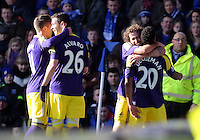 Pictured: Jonathan de Guzman of Swansea (R) with team mates Pablo Hernandez, Alvaro Vazquez and Jose Canas celebrating his equaliser making the score 1-1. Sunday 16 February 2014<br />
