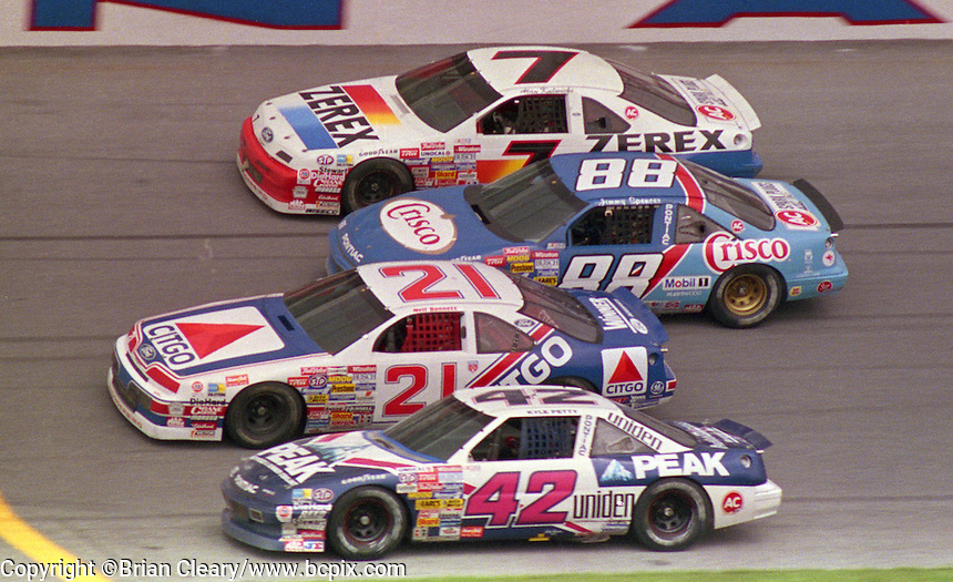 Kyle Petty, Neil Bonnett, Jimmy Spencer, Alan Kulwicki 4-wide racing trioval Daytona 500, Daytona International Spedway, Daytona Beach, FL on February 19, 1989. (Photo by Brian Cleary/www.bcpix.com)