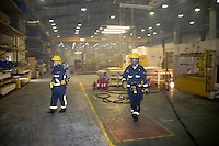 Firefighters in breathing apparatus inside a factory unit which has been set alight by arsonists. Warwickshire UK. This image may only be used to portray the subject in a positive manner..©shoutpictures.com..john@shoutpictures.com
